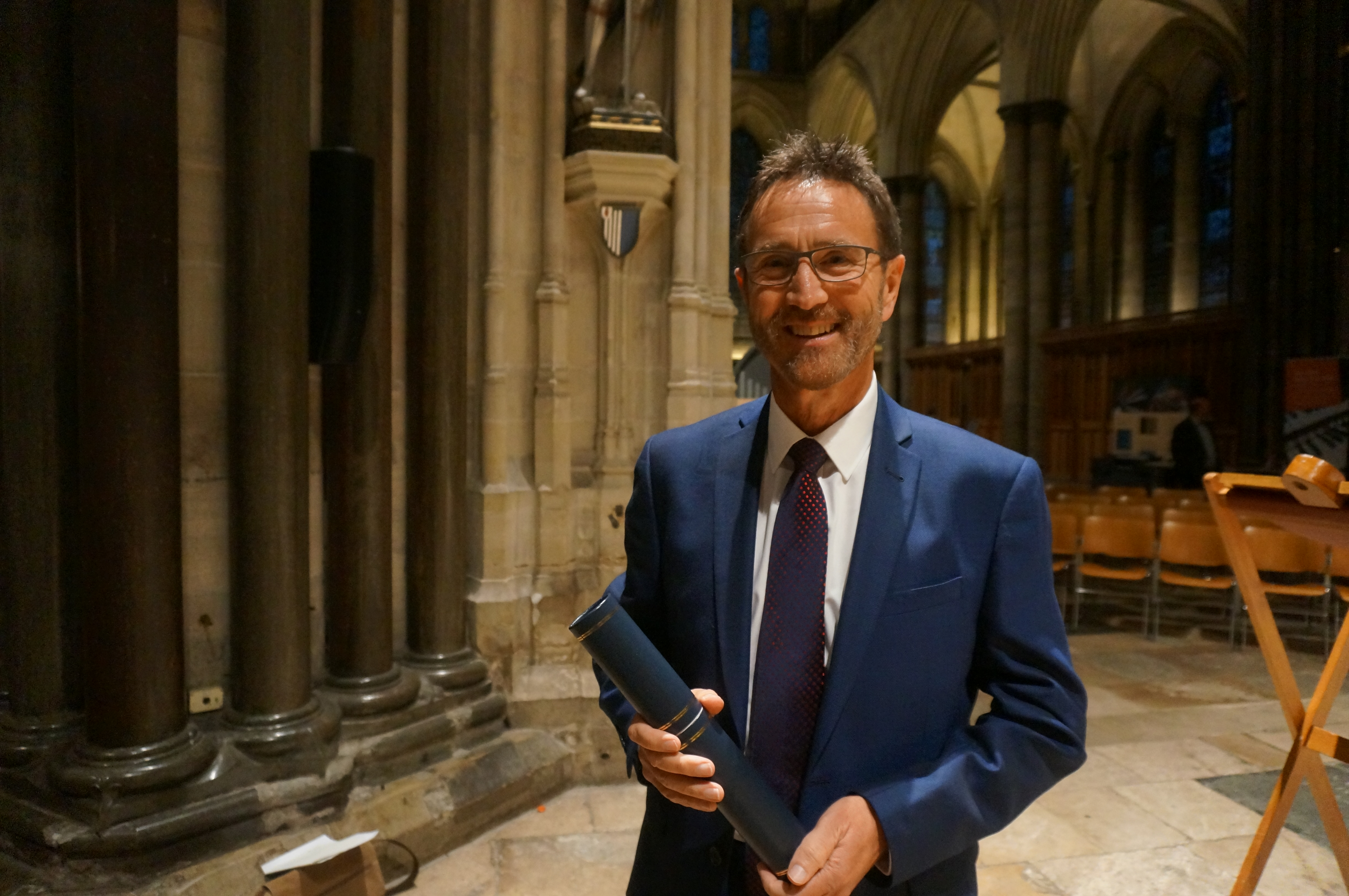 Simon in Salisbury Cathedral last year receiving his award from the RSCM